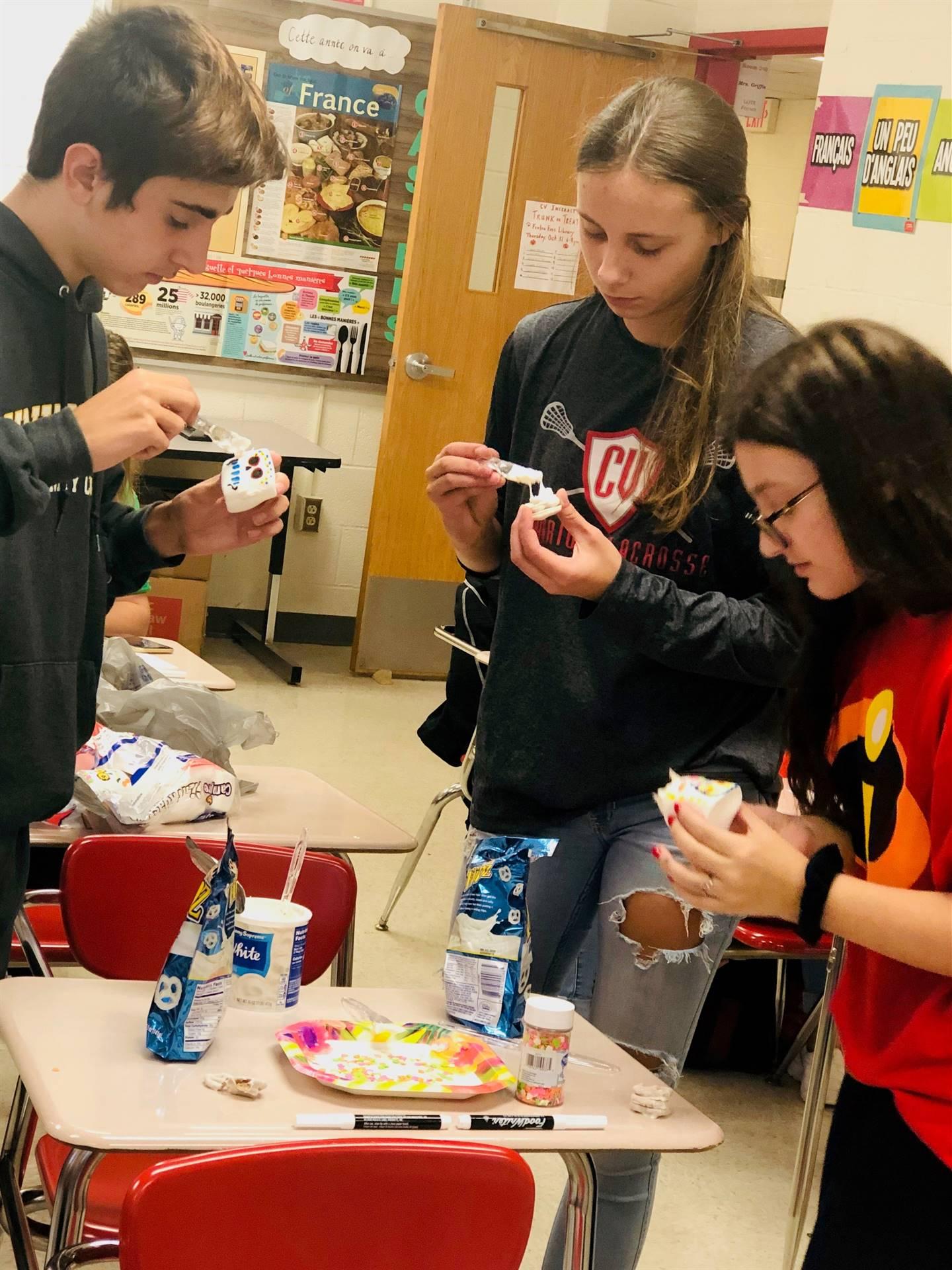 high school students taking part in halloween activity