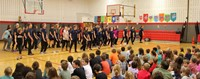 wide shot of middle school students performing snippet in Port Dickinson Elementary gym