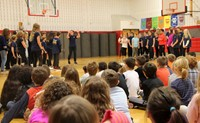 Port Dickinson Elementary students watching middle school students perform