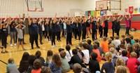 Port Dickinson elementary students clapping for middle school students