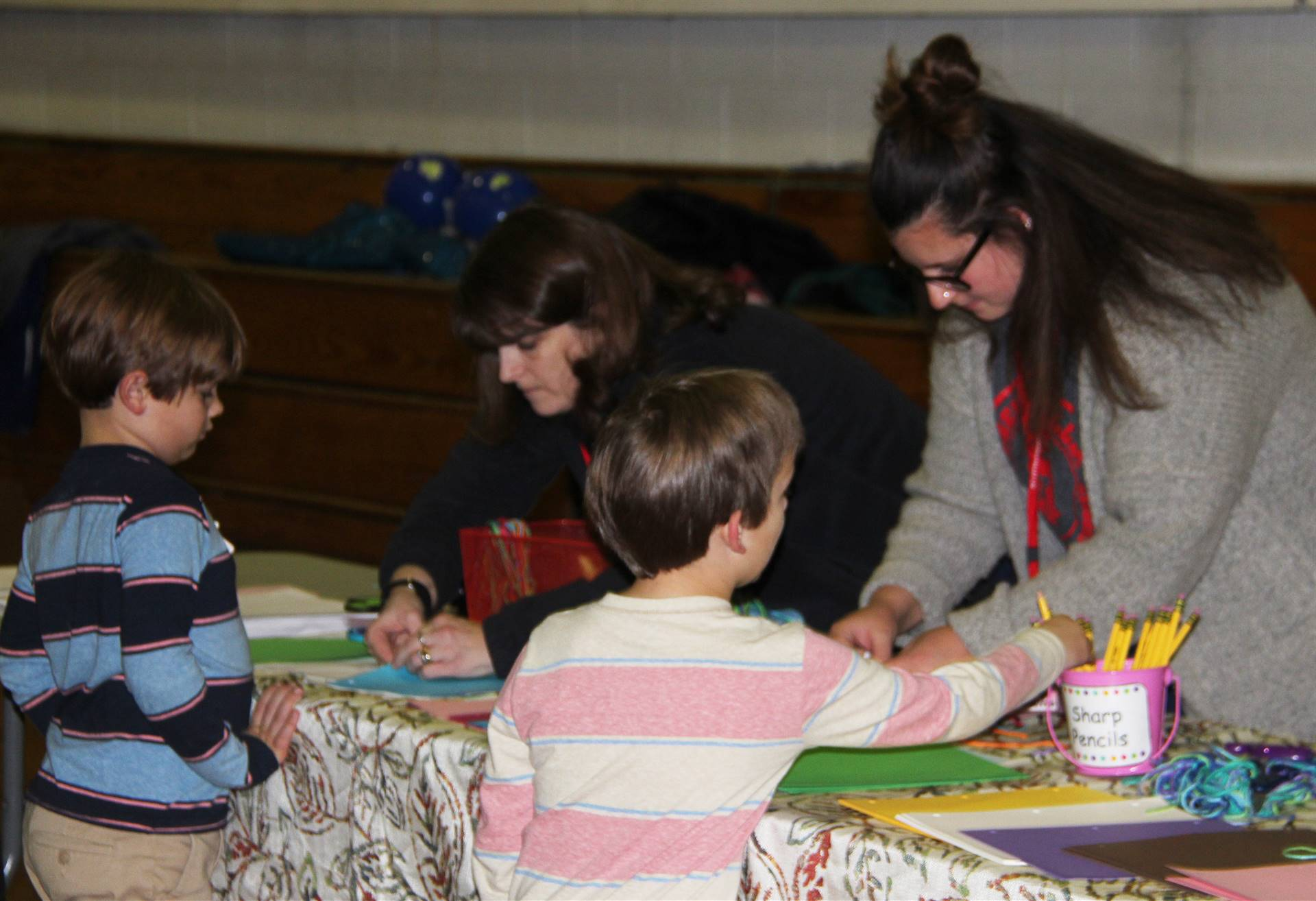 students and adults at activity station