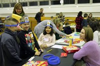 students and adult playing head bandz game