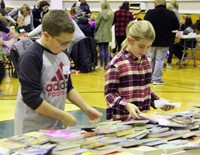two students looking at books