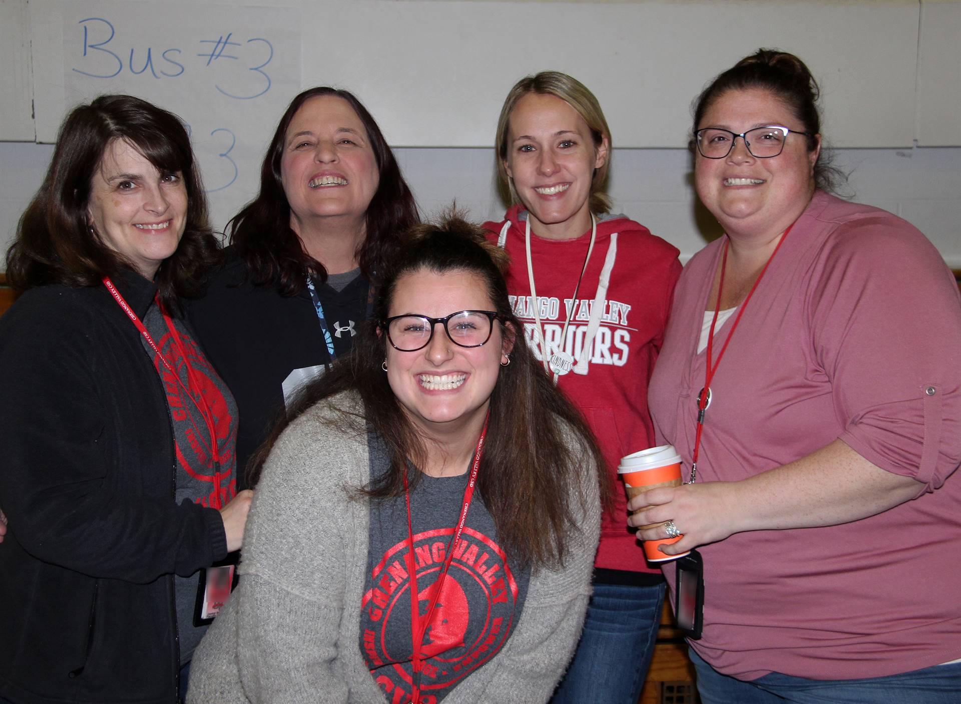 five teachers smiling
