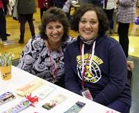 two educators smiling
