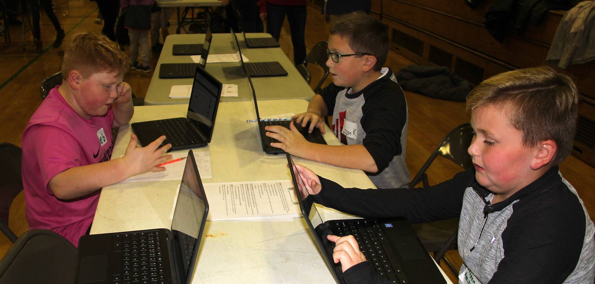 students on computers at activity station