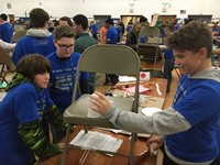 high school students taking part in engineering day event