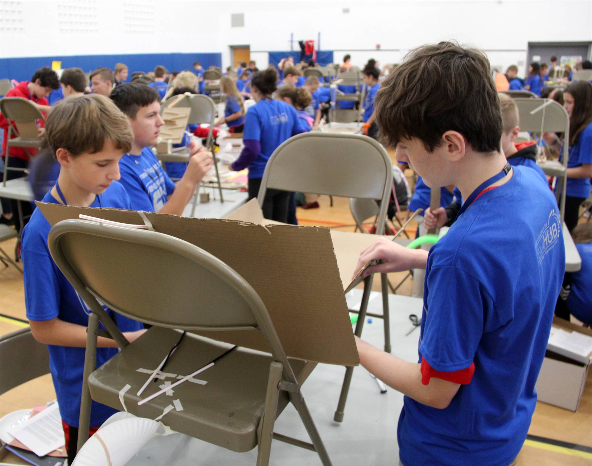 middle school students taking part in engineering day activity