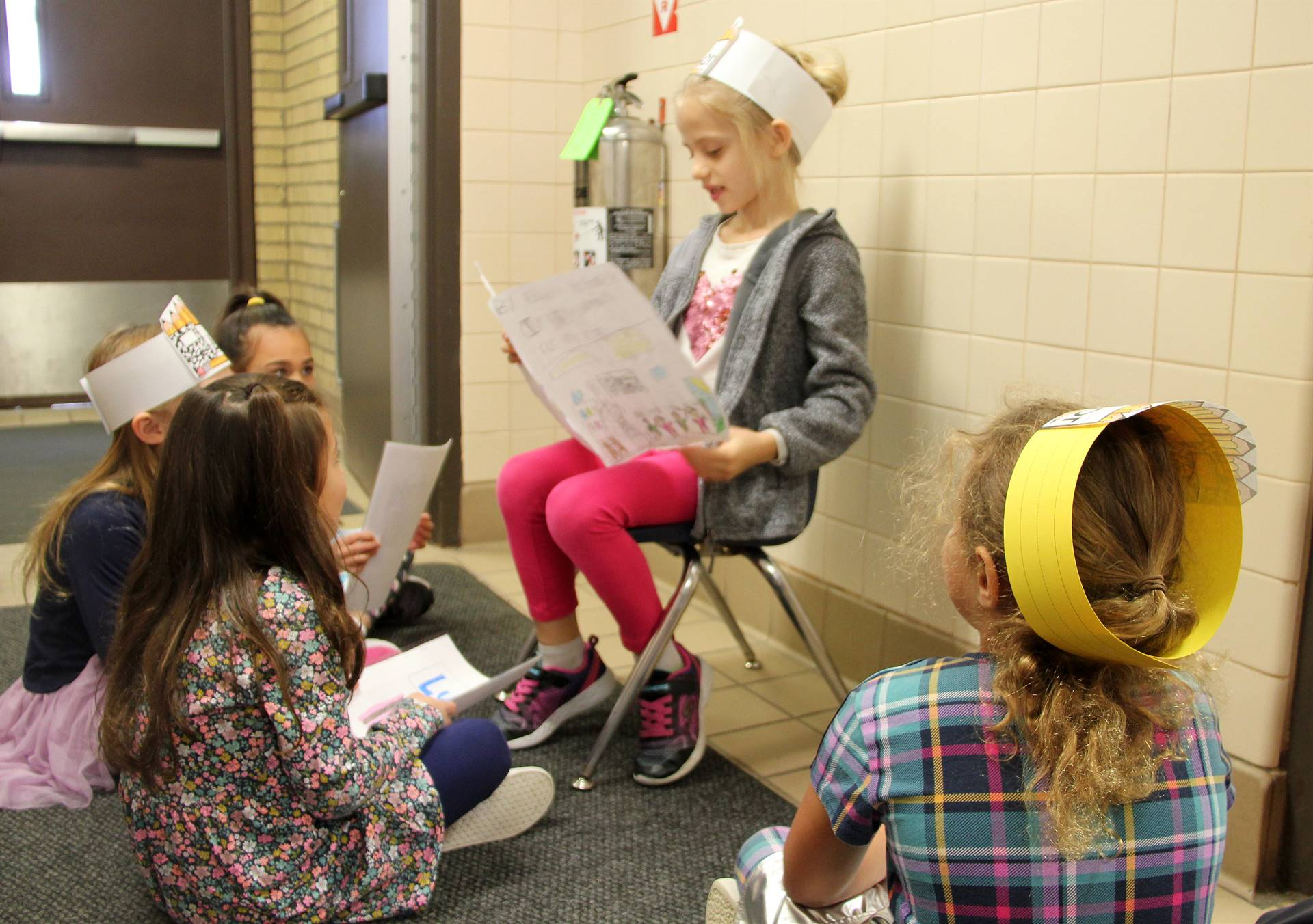 student reading to peers