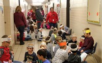 hallway of students reading to peers