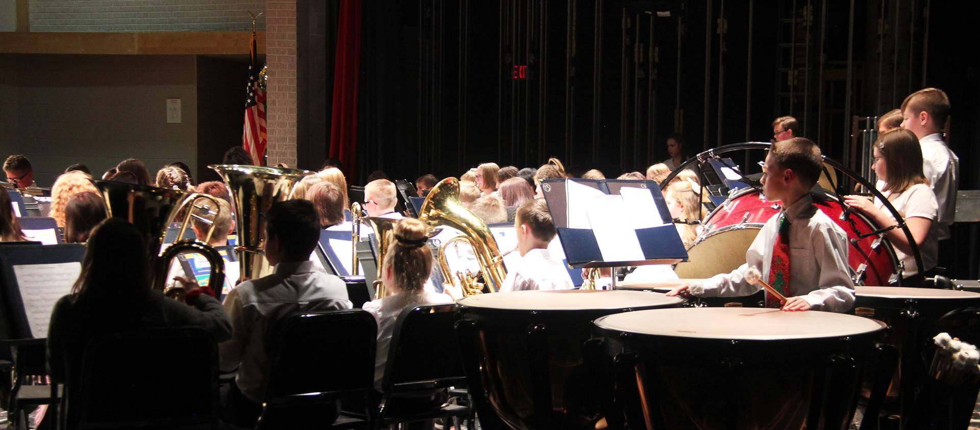 medium shot of seventh and eighth grade band students performing