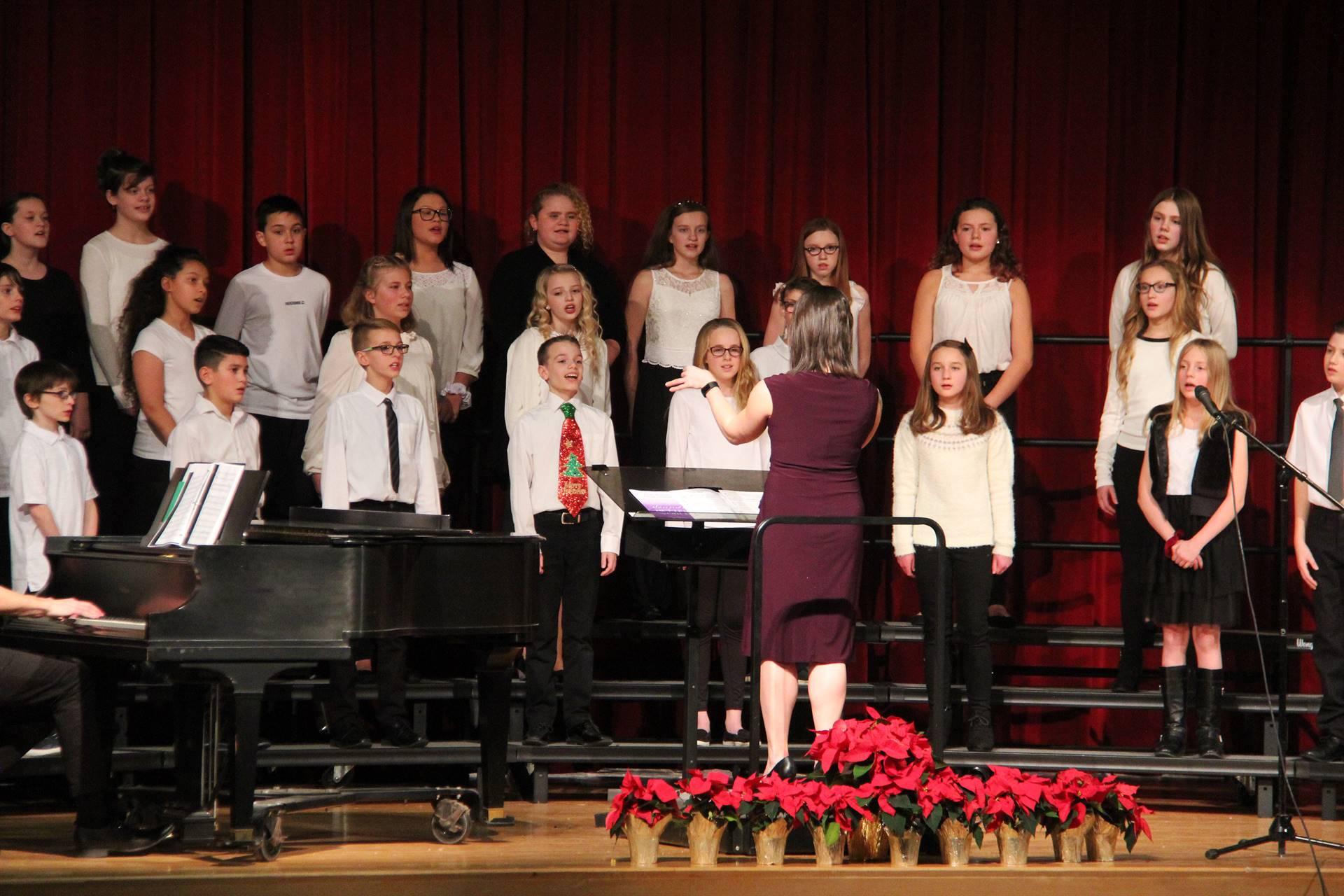 medium shot of sixth grade chorus members singing