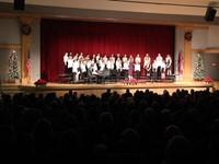 wide shot of sixth grade chorus members singing
