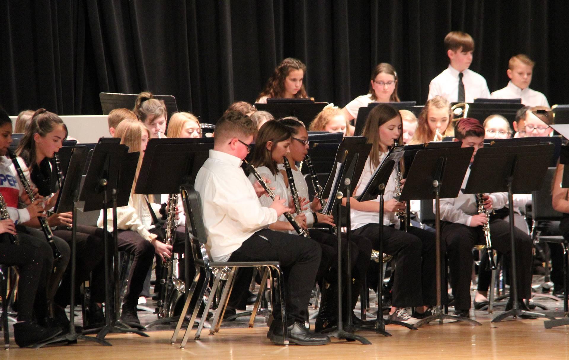 medium shot of sixth grade band performing