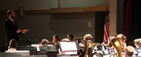 medium shot of seventh and eighth grade band performing