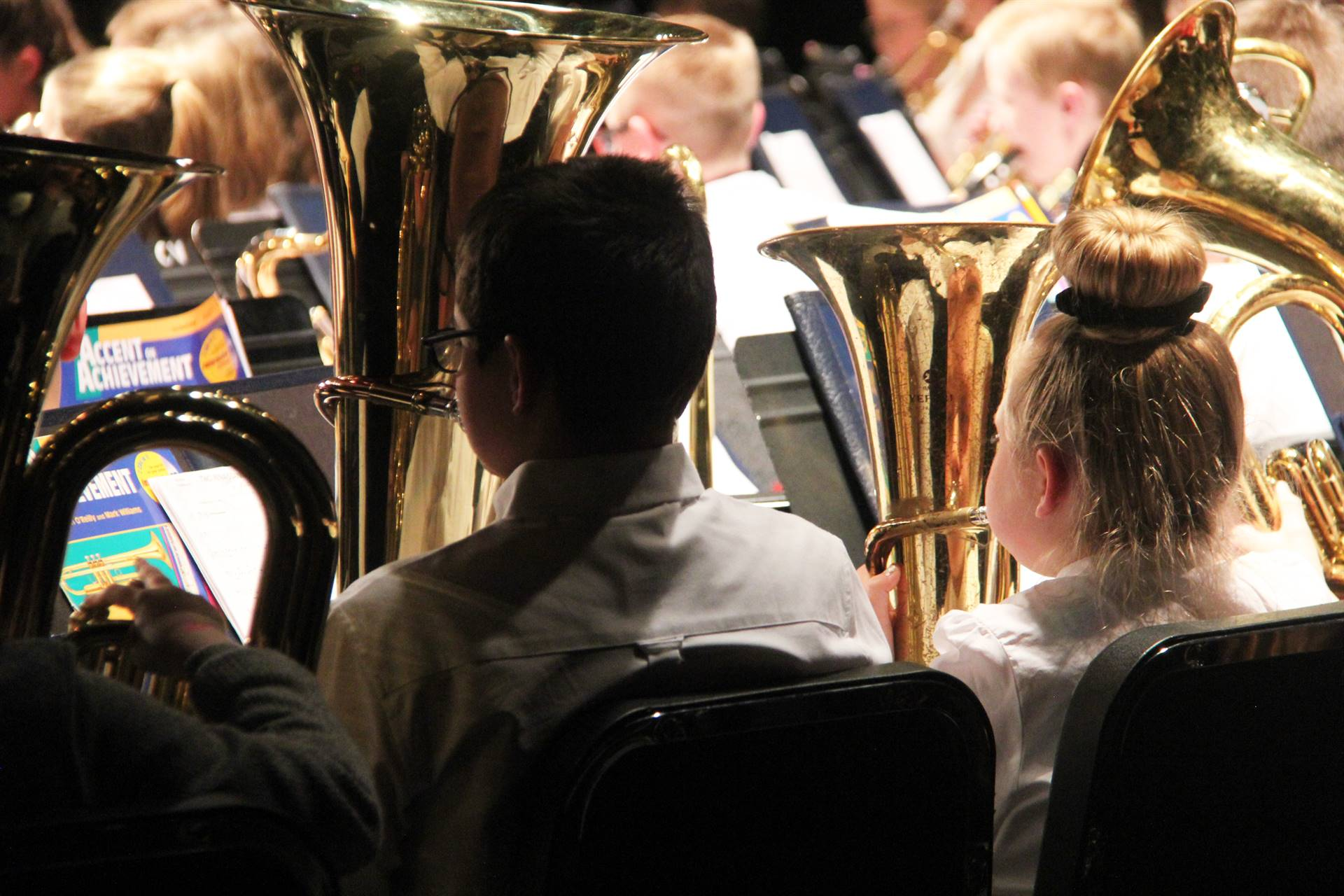 close up of students playing brass instruments