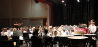 wide shot of seventh and eighth grade band members performing