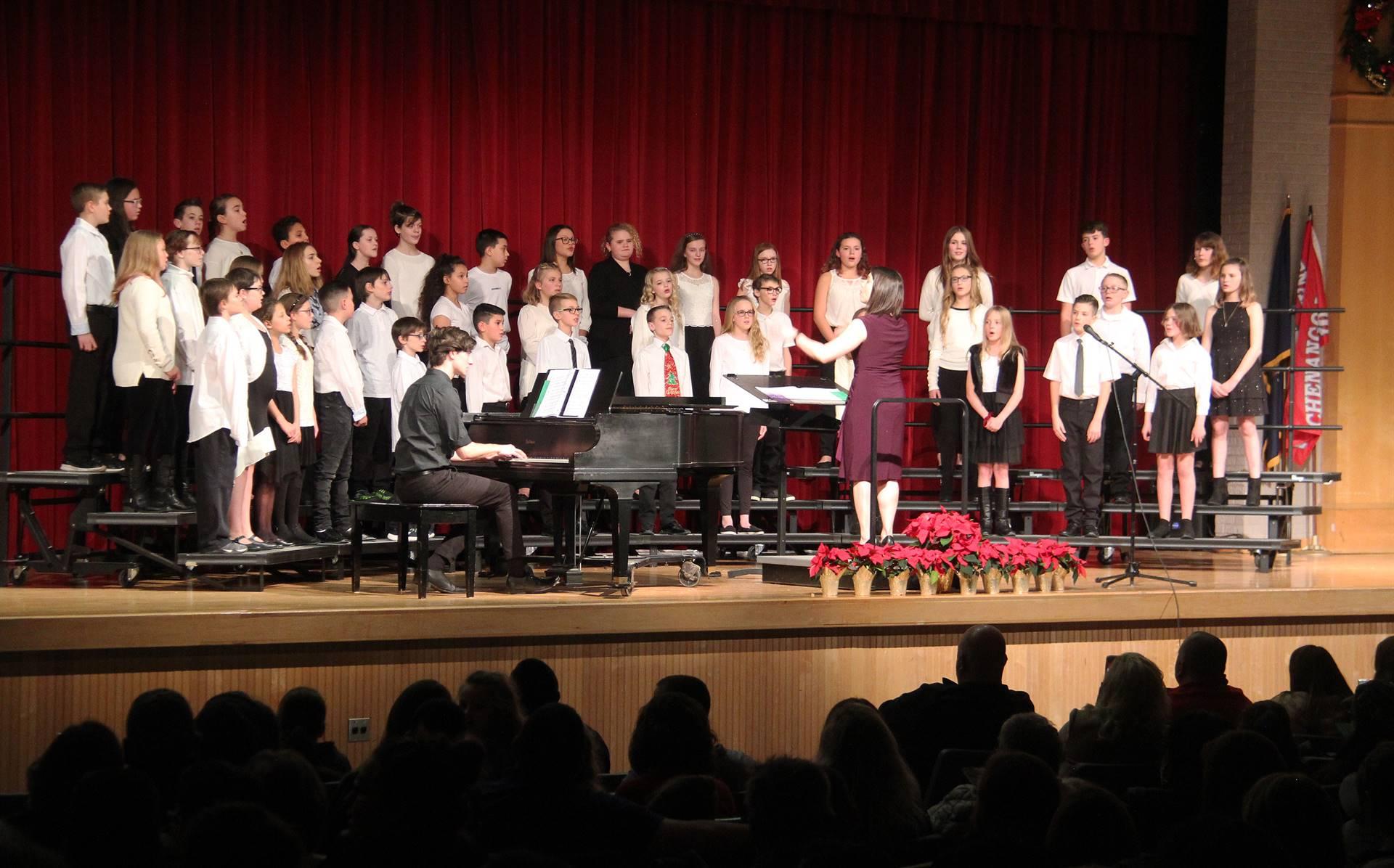 sixth grade chorus members singing