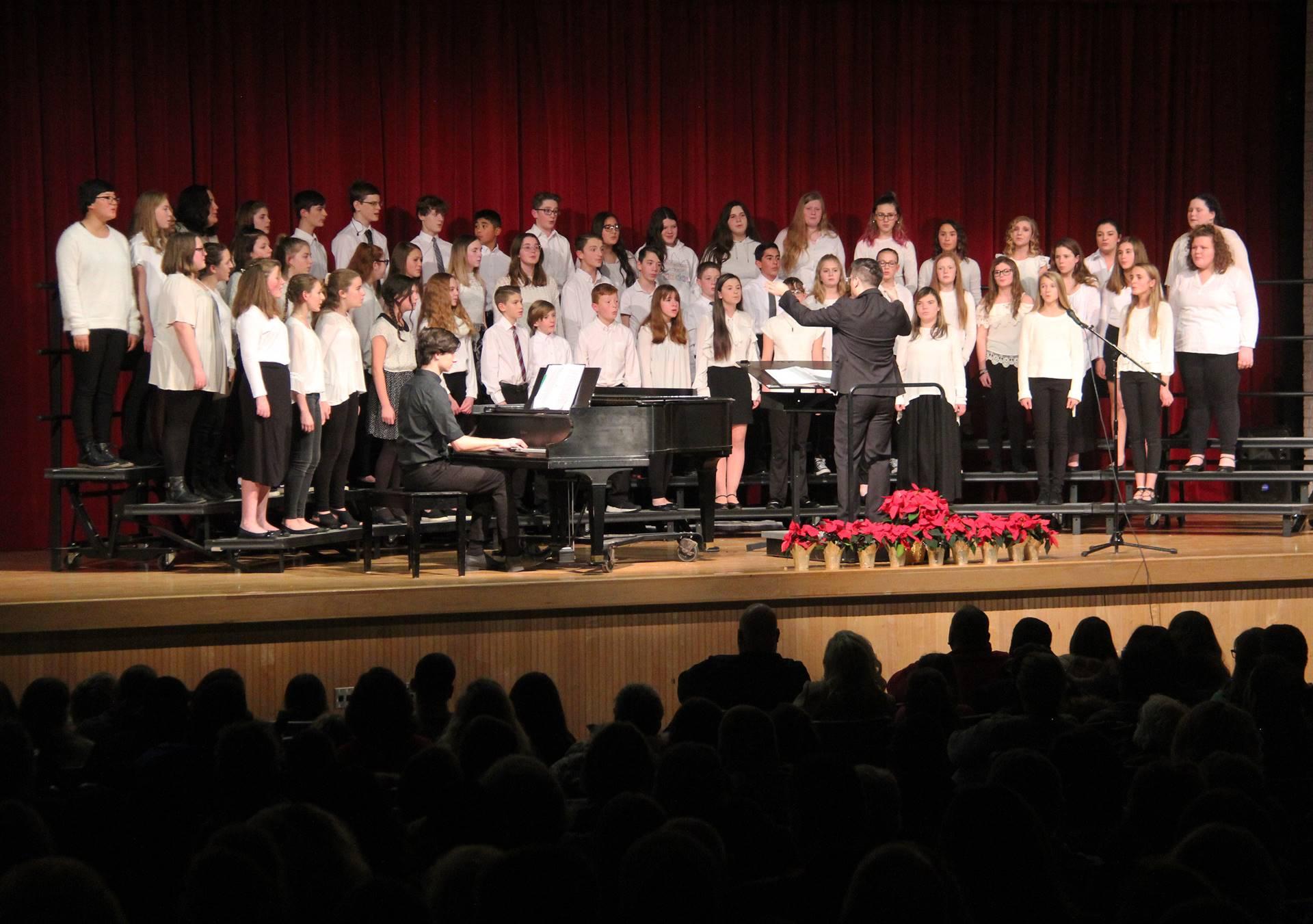 seventh and eighth grade chorus members singing