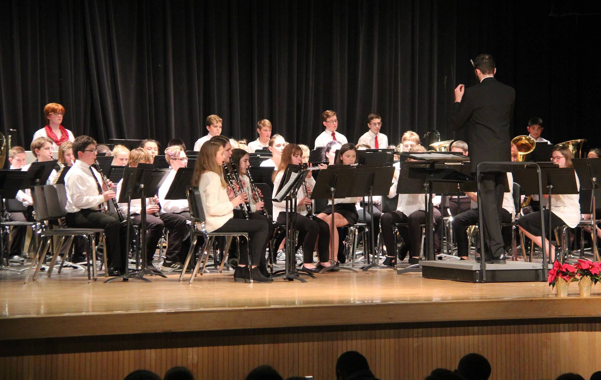 medium shot of seventh and eight grade band performing