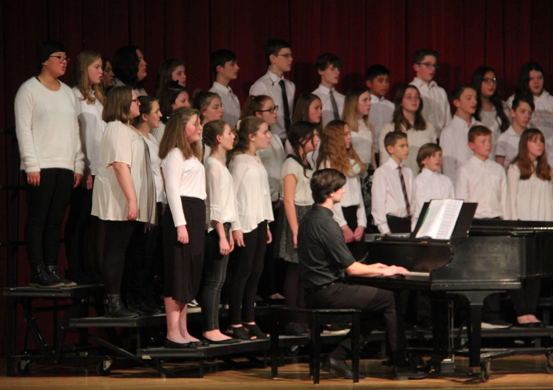 medium shot of seventh and eighth grade chorus members singing