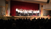 wide shot of seventh and eighth grade chorus members singing