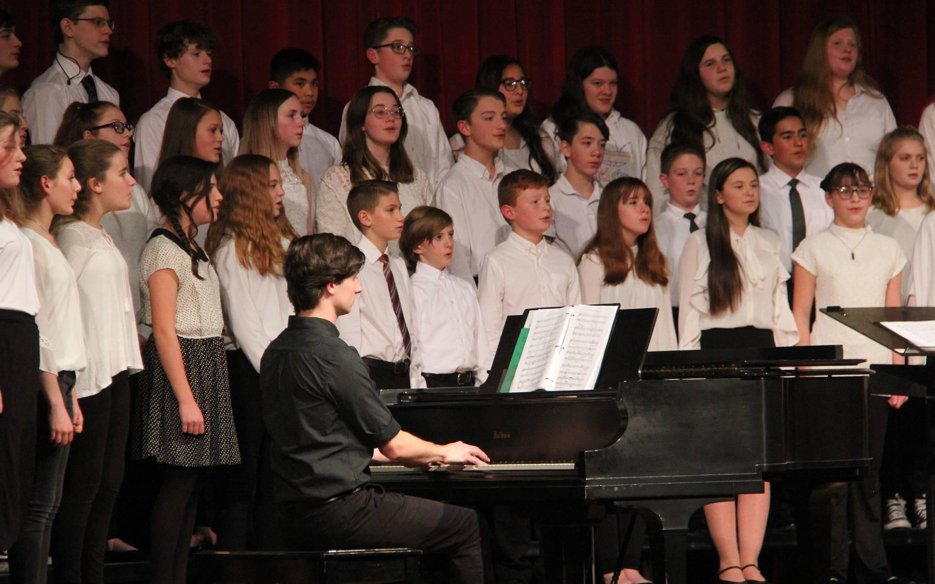 another medium shot of seventh and eighth grade chorus members singing