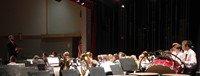 seventh and eighth grade band students performing