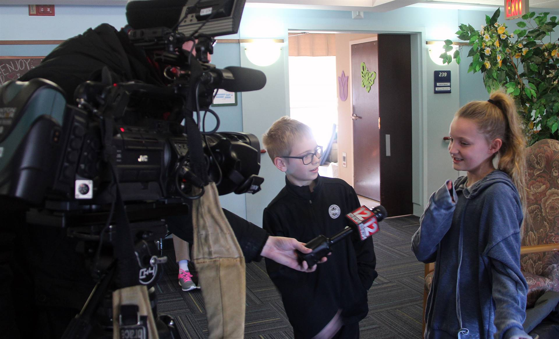 students speaking with reporter