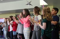 chorus director leading students