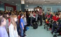students performing for elizabeth church manor residents