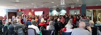 wide shot of students singing for elizabeth church manor residents