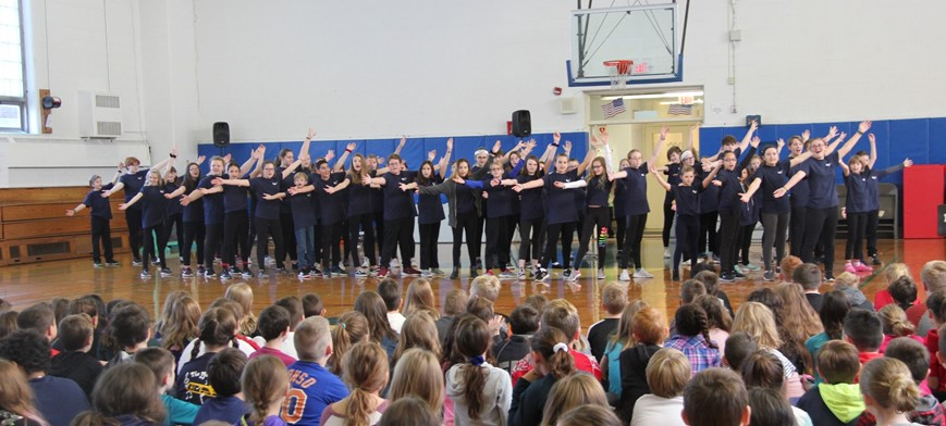 middle school students performing at elementary school