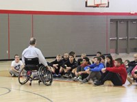 adaptive sports instructor speaking with students