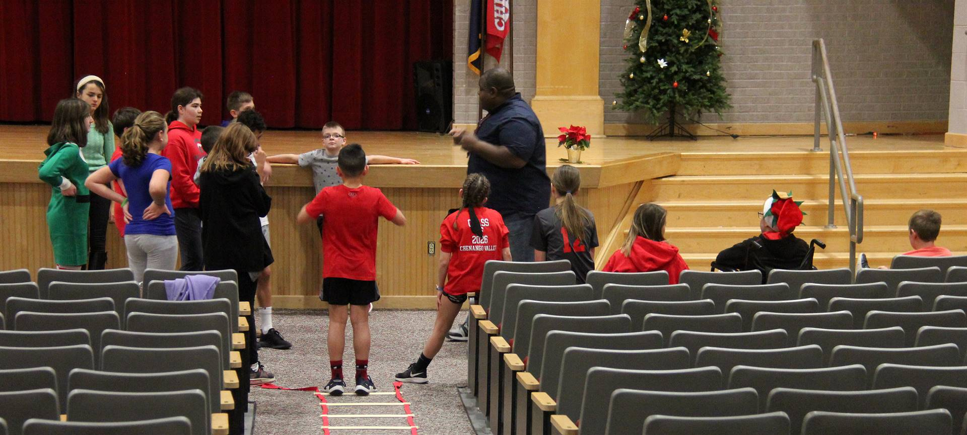 agility instructor speaking with students