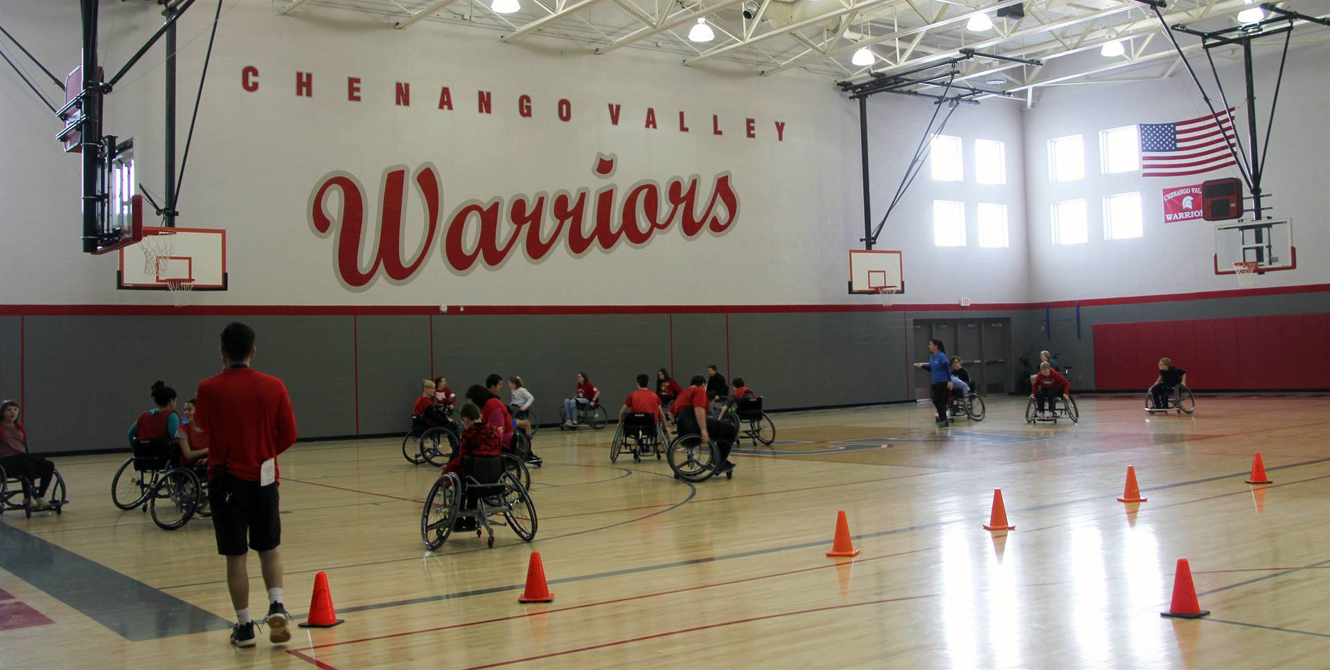 wide shot of students taking part in adaptive sports in gymnasium