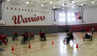 students taking part in adaptive sports in gymnasium