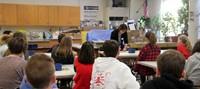 wide shot of presenters giving nutrition presentation