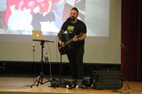 closer shot of jared campbell performing for students