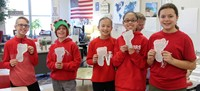 students holding carbon footprint projects