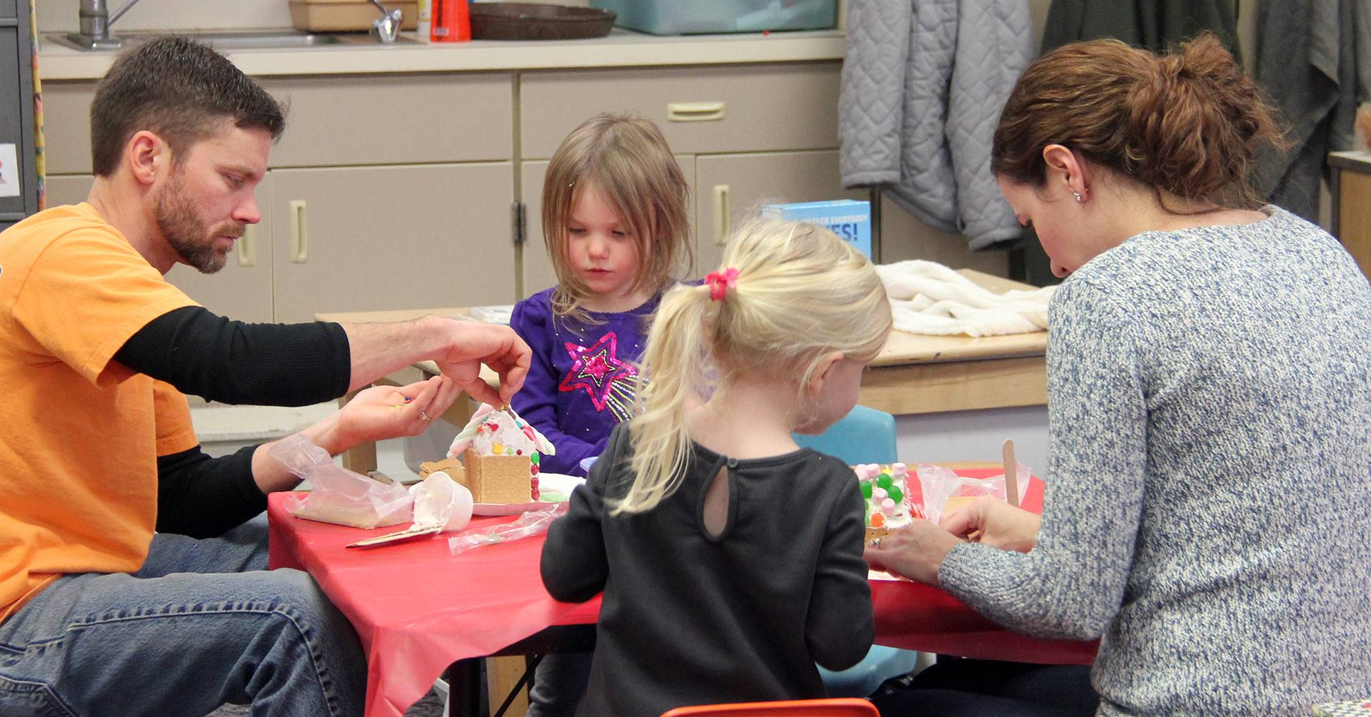 people working on gingerbread houses