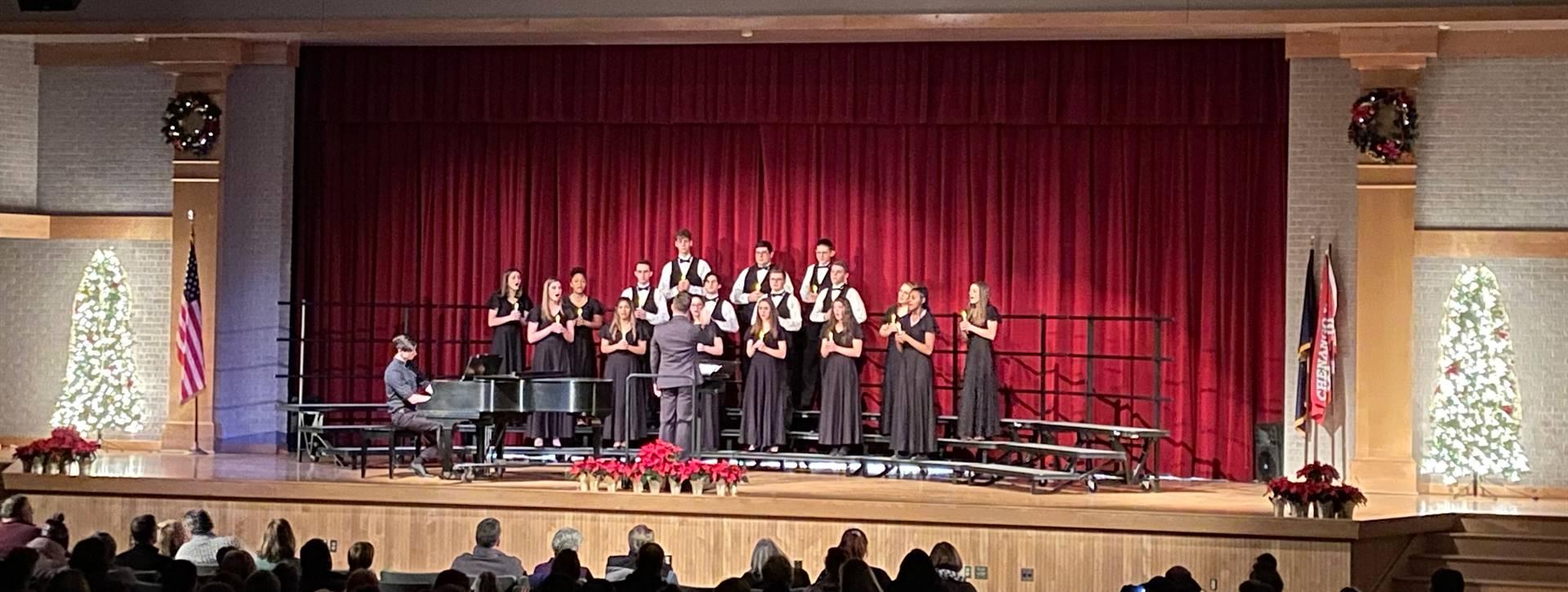 wide shot of students singing in winter concert