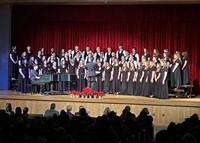 medium shot of students singing in winter concert