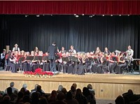 students playing instruments in winter concert
