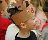 student wearing reindeer hat