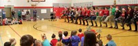 teachers doing a dance performance for students
