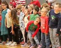 students dancing and singing
