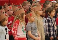 students wearing reindeer hats