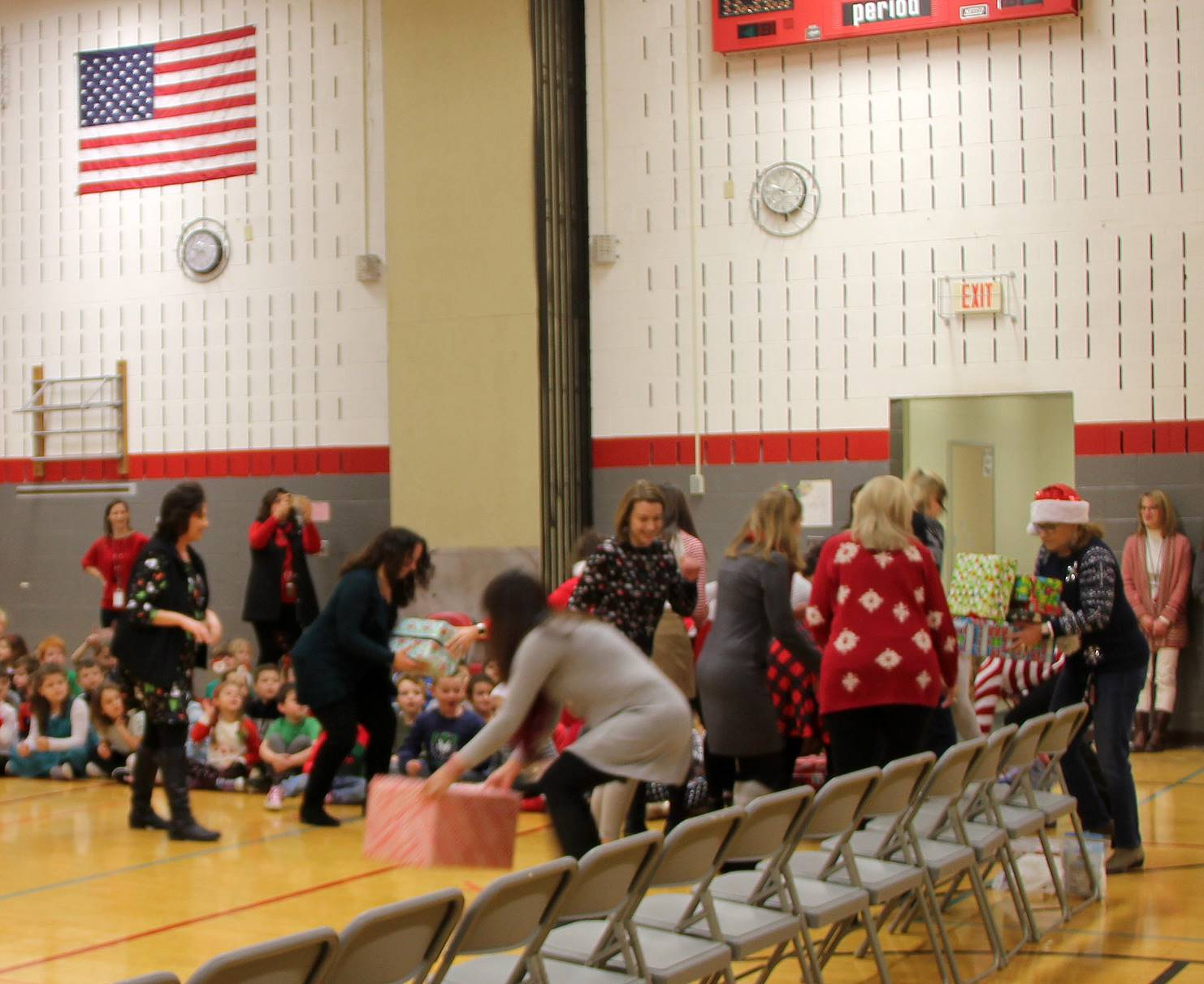 wide shot of teachers stacking presents for activity