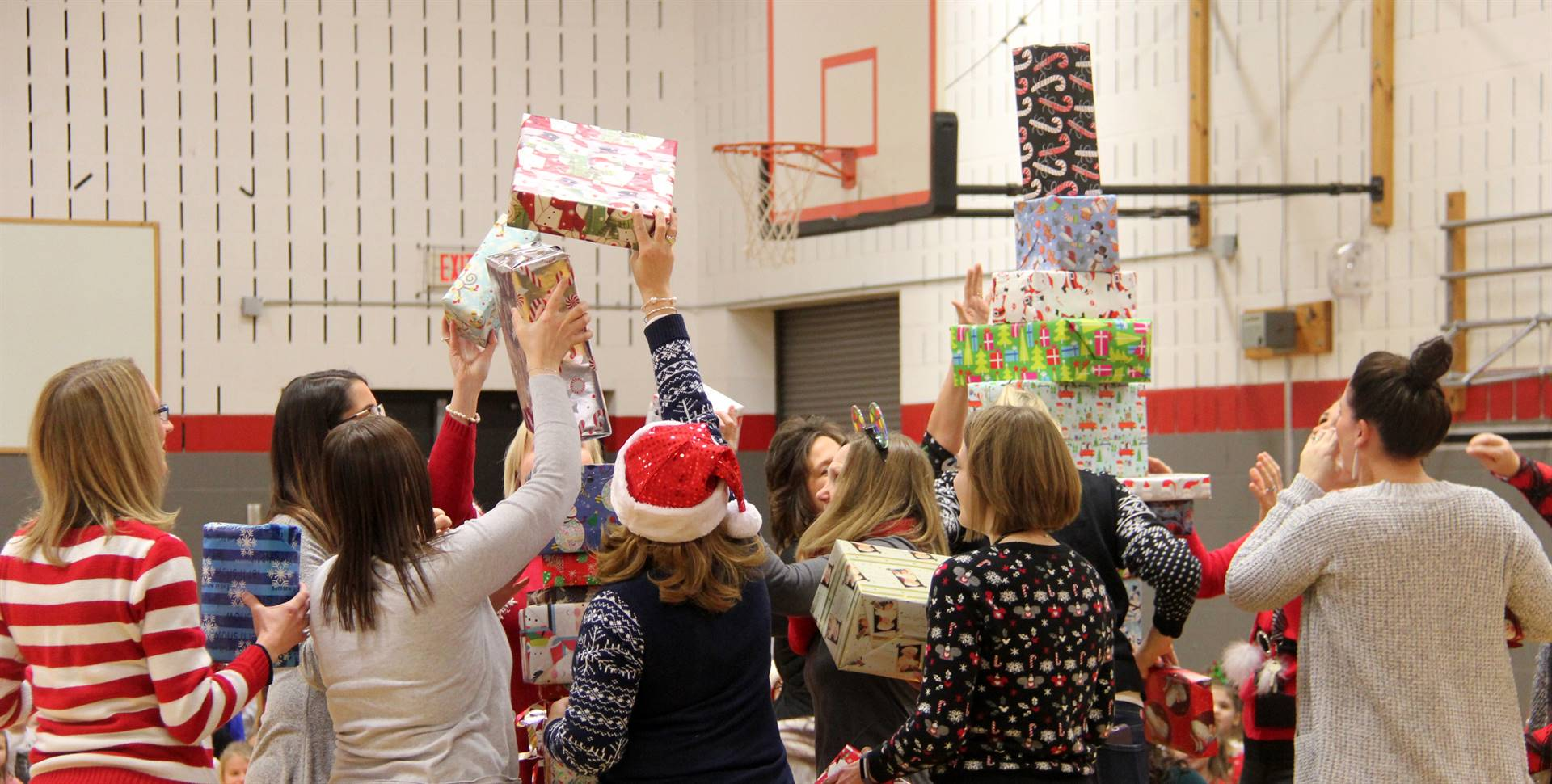 medium shot of teachers stacking presents for activity